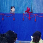 Puppets act out the story of Cain and Abel