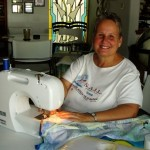 Ilene Kendrick sews a cushion for a custom-built chair for Jose, a child with disabilities.  Oct - 2009