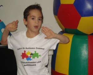 "A boy shows his Centro de Autismo ""school uniform."""