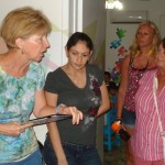 Karen (left) translates for Centro de Autismo Director Carla (2nd from left) during a tour by FOC volunteers.