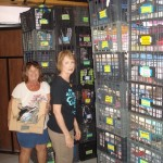 Sandy and Rita stack crates of Bazar items.