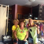 Karen, Sandy and Kristin prepare items to sell at the Gran Bazar.