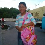 This backpack is filled with materials required by her school.