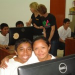 Although students have to share equipment, they're happy to have an opportunity to learn computer use.