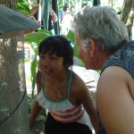 Karla (left) and Ilene discover a parrot.