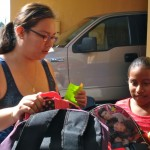Viridiana (left) and Carmen select their backpacks.