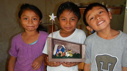 Antonia, Gustavo and Enrique proudly display one of their completed nativity sets