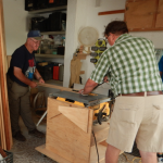 Jerry (left) and Byron constructed shelves for Vida Abundante.