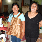 Local volunteer Elena (right) taught workshop participants to make tote bags.