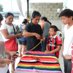 Local volunteer Victor (center) helped lead craft projects.