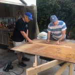 Gary (left) and David measure wood for the countertop.