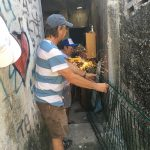 David (left) and Victor use a grinder to create a security door for part of that house that was open to the alley.
