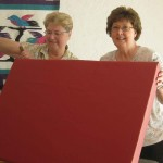 Diane (left) and Becky (right) upholstered a therapy swing pad.