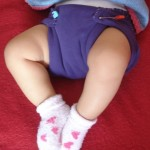 A purple t-shirt gets new life as a diaper.