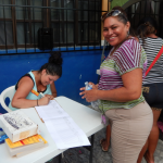 Diana (left) helped with registration.