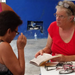 Ellen (right) helped fit reading glasses donated by FOC supporters.