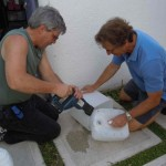 Gary and David cut recycled plastic jobs for container gardens.