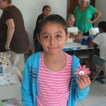 A craft class included making flowers from fabric.