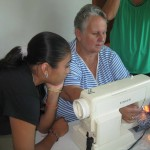 Ilene (right) demonstrates at the sewing class.