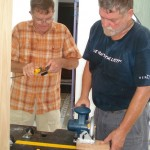 Byron (left) and David (right) often worked in the heat on building and fixing duties.