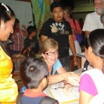 Karen (center) organizes many of the FOC projects for mission weeks as well as throughout the year.