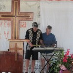 Larry (right) with Gary (left) provides music for a local church when he's not building, toting, fixing or helping others.