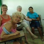 Lia (left), Lynn (2nd from left) and Treva (center) talked with students learning English.