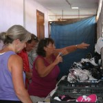 Phyllis (left), Ray (center) and Sandy (right) inventory shoes at the school supplies distribution.