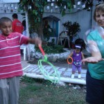 Susan (right) helped Luisito (left) master the giant bubble wand at day camp.