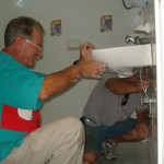 Ray (left) helps Gary fix bathroom fixtures at Casita Corazon.