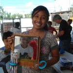 Perla is happy to have a place to store her family's toothbrushes.