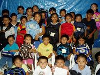 Children receiving school supplies