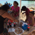 New snorkelers enjoy nachos after their time in the water.