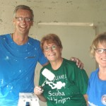 Emile, Mary Jo (center) and Jan didn't mind getting a bit dirty in their work.