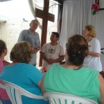 Pastor Salomon (center) explains the goals of Vida Abundante.