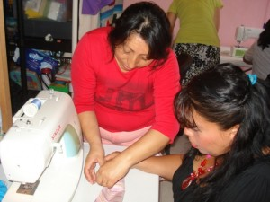 Elena (left) made an excellent instructor at the sewing workshop.