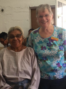 Rita (left) had never used an electric sewing machine, but FOC volunteer Ellen helped her learn.