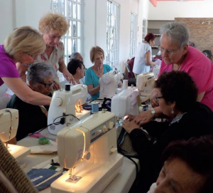 FOC volunteers helped participants learn to use a sewing machine.