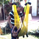Jose and his therapist try out the new sling swing.