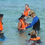 Karen (right) worked with first-time snorkeler Rosa.