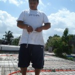 Pastor Soloman joined the volunteers preparing the roof for concrete.