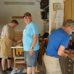 Byron, Keith and Larry prepare materials in the wood shop for the water purification project.