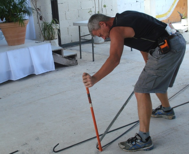 Larry Bends The Rebar Before Carrying It To Roof